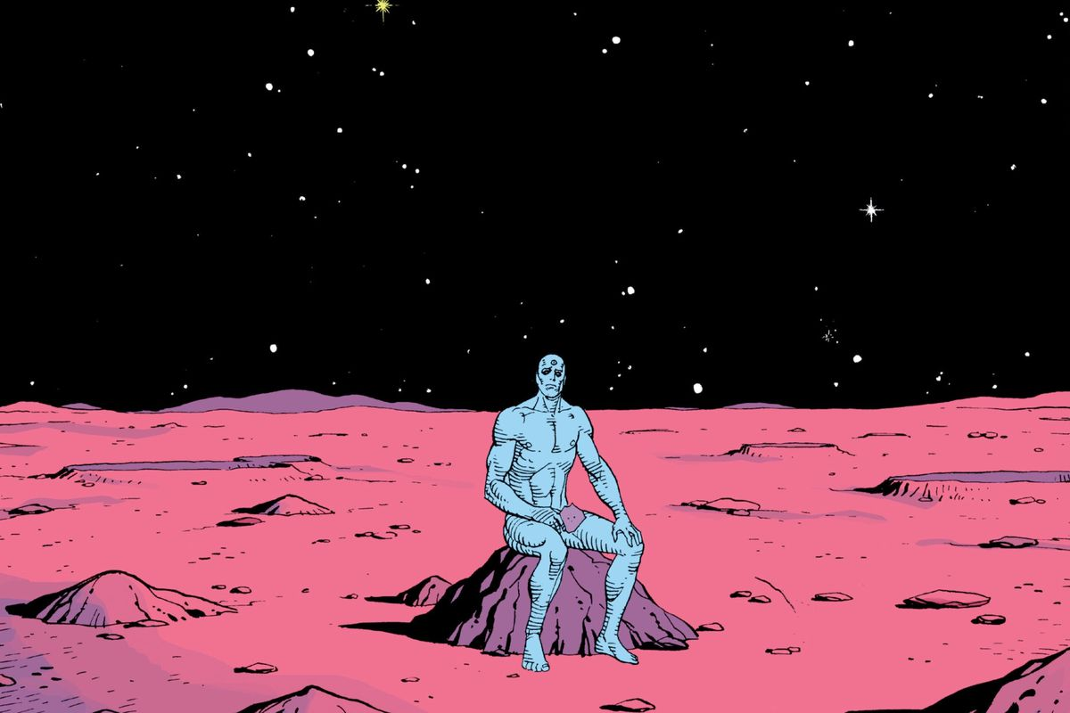 Doctor Manhattan sits on a rock on mars, holding an old photograph, in Watchmen, DC Comics (1986).