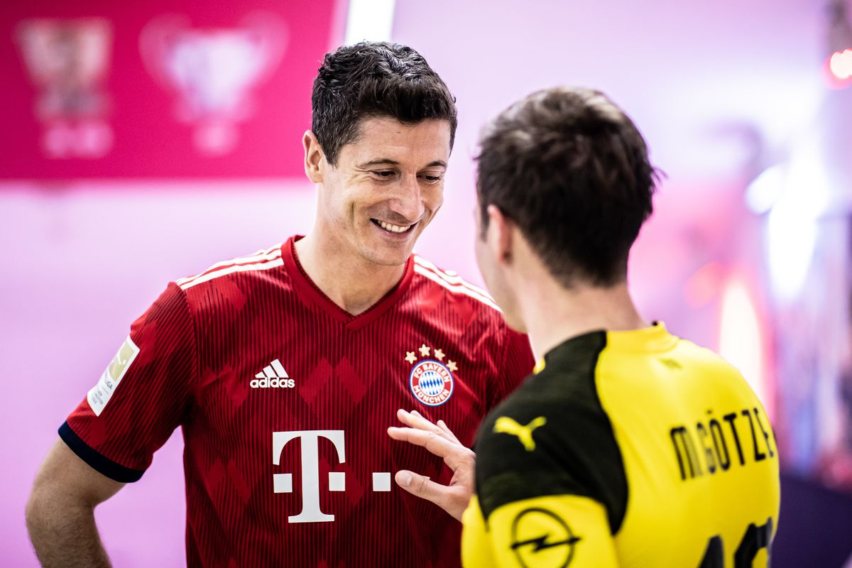 MUNICH, GERMANY - APRIL 06: (EDITORS NOTE: Image has been digitally enhanced.) Robert Lewandowski of Muenchen chats with Mario Goetze of Dortmund in the tunnel during the Bundesliga match between FC Bayern Muenchen and Borussia Dortmund at Allianz Arena on April 6, 2019 in Munich, Germany.