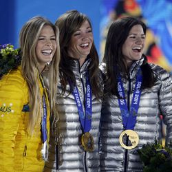 Women's snowboard halfpipe medalists, from left, Torah Bright of Australia, silver; Kaitlyn Farrington of the United States, gold; and Kelly Clark of the United States, bronze, pose with their medals at the 2014 Winter Olympics in Sochi, Russia, Thursday, Feb. 13, 2014.