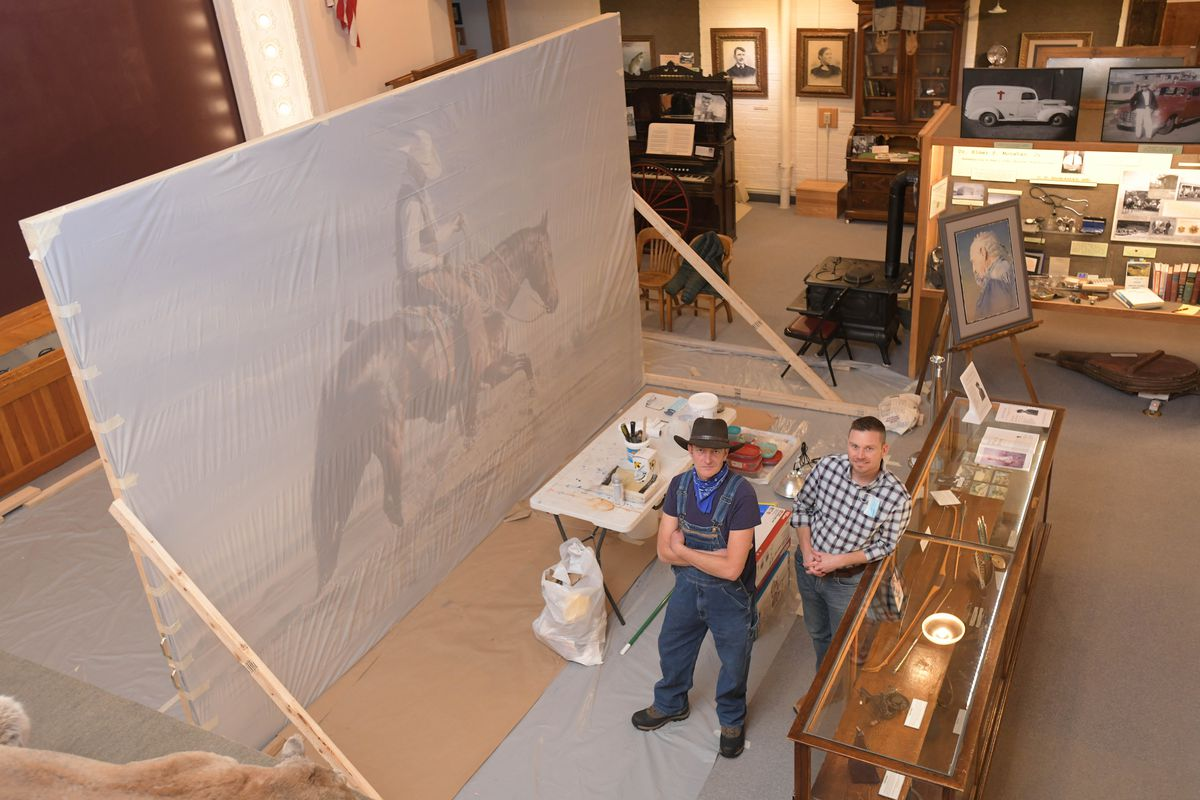 Museum of Northwest Colorado Assistant Director Paul Knowles, right, is pictured with local artist Israel Holloway at the museum in Craig, Colorado.