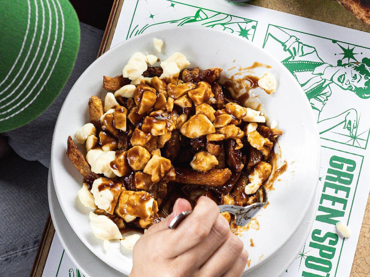 """poutine with """"greenspot"""" placemat"""