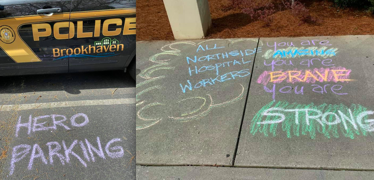 A photo of sidewalks with chalk on them.