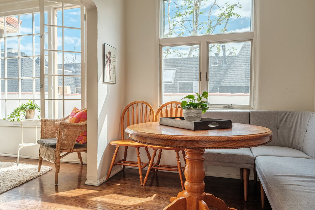 A table set up in a dining nook.