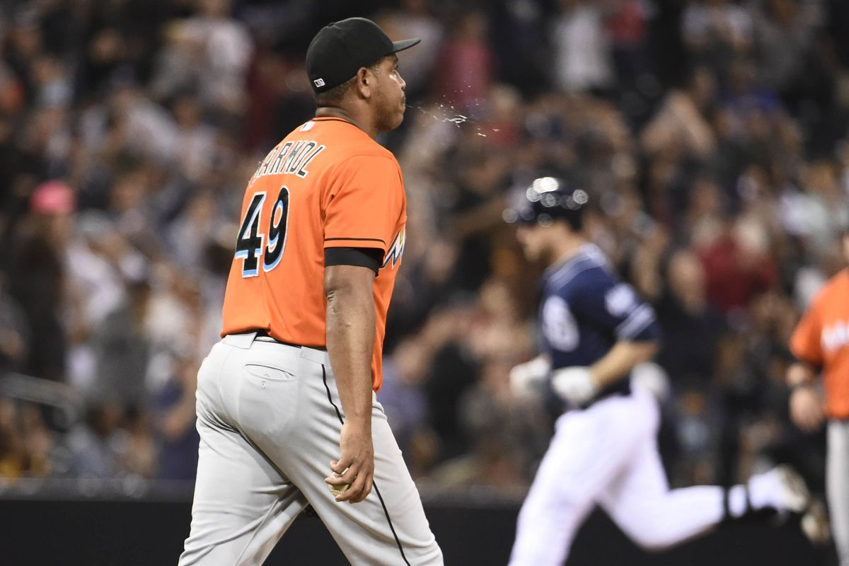 Carlos Marmol in a typical pose, watching a hitter who hit a home run off him circle the bases. This one's likely his last, hit by the Padres' Chase Headley.
