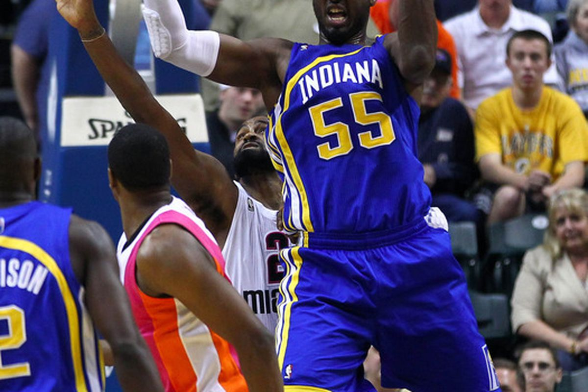 March 26, 2012; Indianapolis, IN, USA; Indiana Pacers center Roy Hibbert (55) grabs a rebound against the Miami Heat at Bankers Life Fieldhouse. Indiana defeated Miami 105-90. Mandatory credit: Michael Hickey-US PRESSWIRE