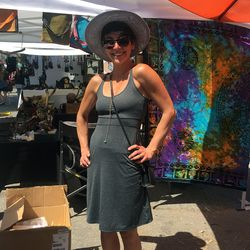 Lil Things owner Tomiina beat the heat in a chic hat.