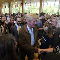 Libertarian vice presidential candidate Gov. Bill Weld shakes hands as he and presidential candidate Gov. Gary Johnson exit after speaking in Salt Lake City at the University of Utah on Saturday, Aug. 6, 2016.