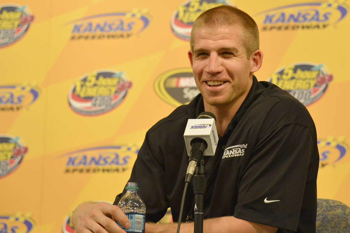 Jordy Nelson is interviewed before driving the pace car at a NASCAR race at Kansas Speedway in May.