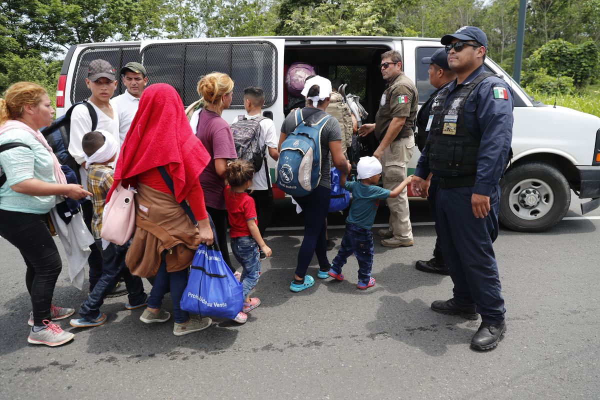 Migrants are loaded into a van by Mexican immigration authorities during a raid on a migrant caravan on June 5.