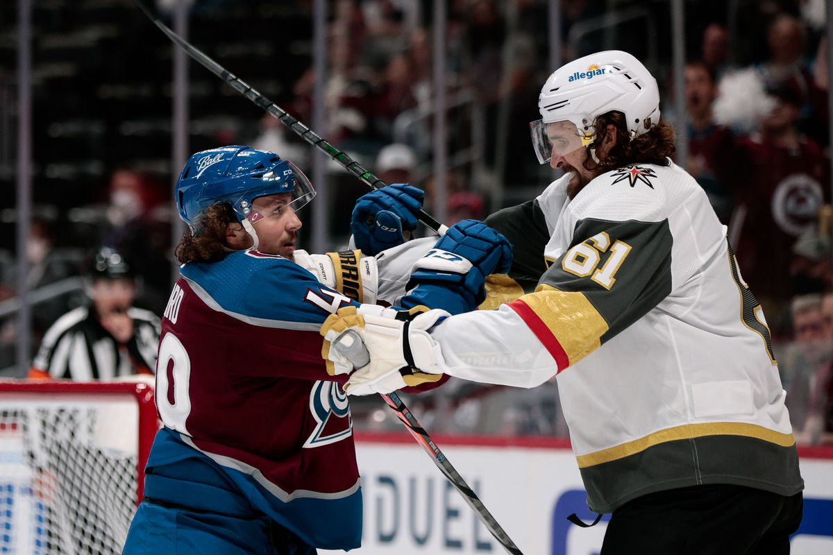 Colorado Avalanche defenseman Samuel Girard (49) pushes Vegas Golden Knights right wing Mark Stone (61) after a play in the third period in game five of the second round of the 2021 Stanley Cup Playoffs at Ball Arena.
