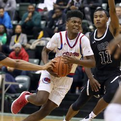 Curie's Damari Nixon (2) drives past Orr's Terry Williams (11) in their CPS semi final game at Chicago State University, Friday, February 15, 2019. | Kevin Tanaka/For the Sun Times