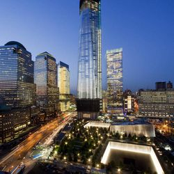 FILE - In this file photo of Sept. 6, 2012, One World Trade Center, now up to 105 floors, rises above the National September 11 Memorial and Museum in New York. Eleven years after terrorists attacked the World Trade Center, the new World Trade Center now dominates the lower Manhattan skyline.