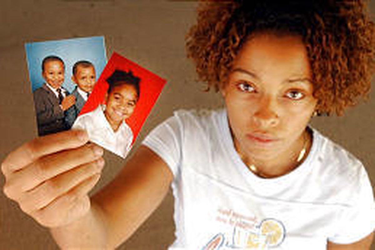 """""""Everybody that belongs to me is in Biloxi, Miss.,"""" Kesha Ainsworth says, displaying photos of her three children: Dewontay, Damion and Alexis."""