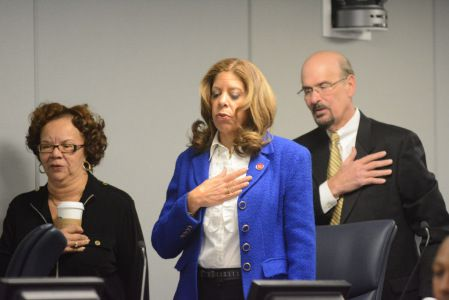 Andrea Zopp, center, saying the Pledge of Allegiance at Chicago Board of Education meeting last March. Sun-Times file phjoto