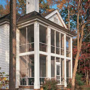 """<p>Rising to a height of 22 ft., this two-story """"back porch"""" is a simple but distinctive complement to the main house. The lower level is off the family room, and the smaller upper level porch serves the master bedroom.</p>"""