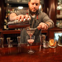 The Clover Club gets double-strained into a Nick & Nora glass.