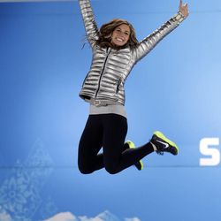 Women's skeleton silver medalist Noelle Pikus-Pace of the United States jumps on the podium in celebration during the medals ceremony at the 2014 Winter Olympics, Saturday, Feb. 15, 2014, in Sochi, Russia.