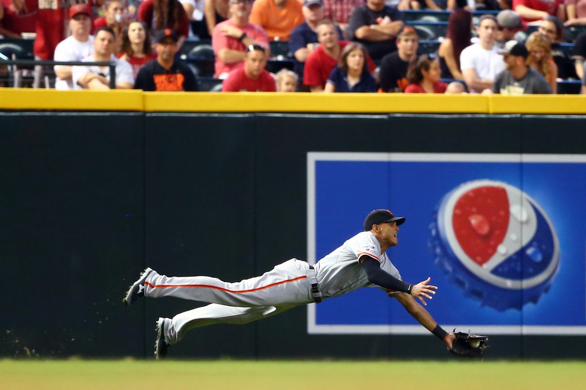 """""""The Giants' Justin Maxwell gives maximum well on this diving catch."""" - Source Unknown"""