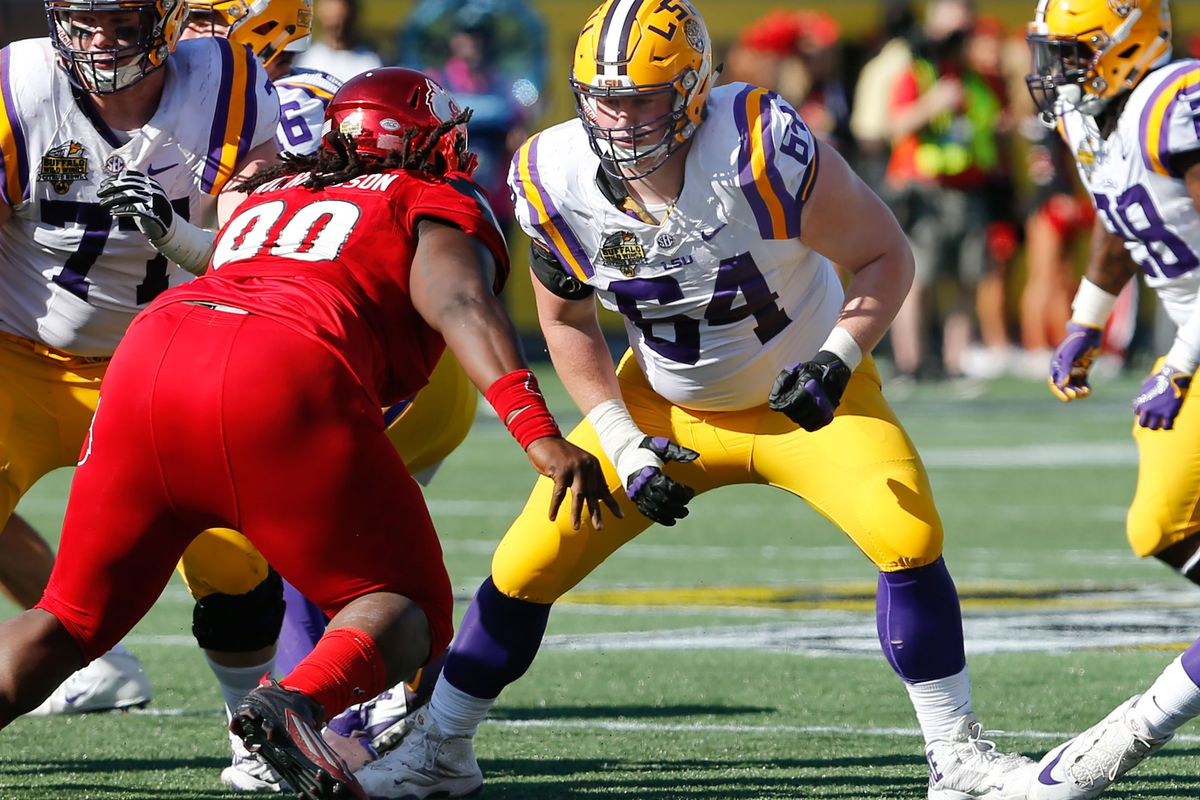 Louisville Cardinals defensive end De'Asian Richardson (90) goes after  LSU Tigers center William Clapp (64) during the second half of an NCAA  football game in the Buffalo Wild Wings Citrus Bowl at Camping World  Stadium.