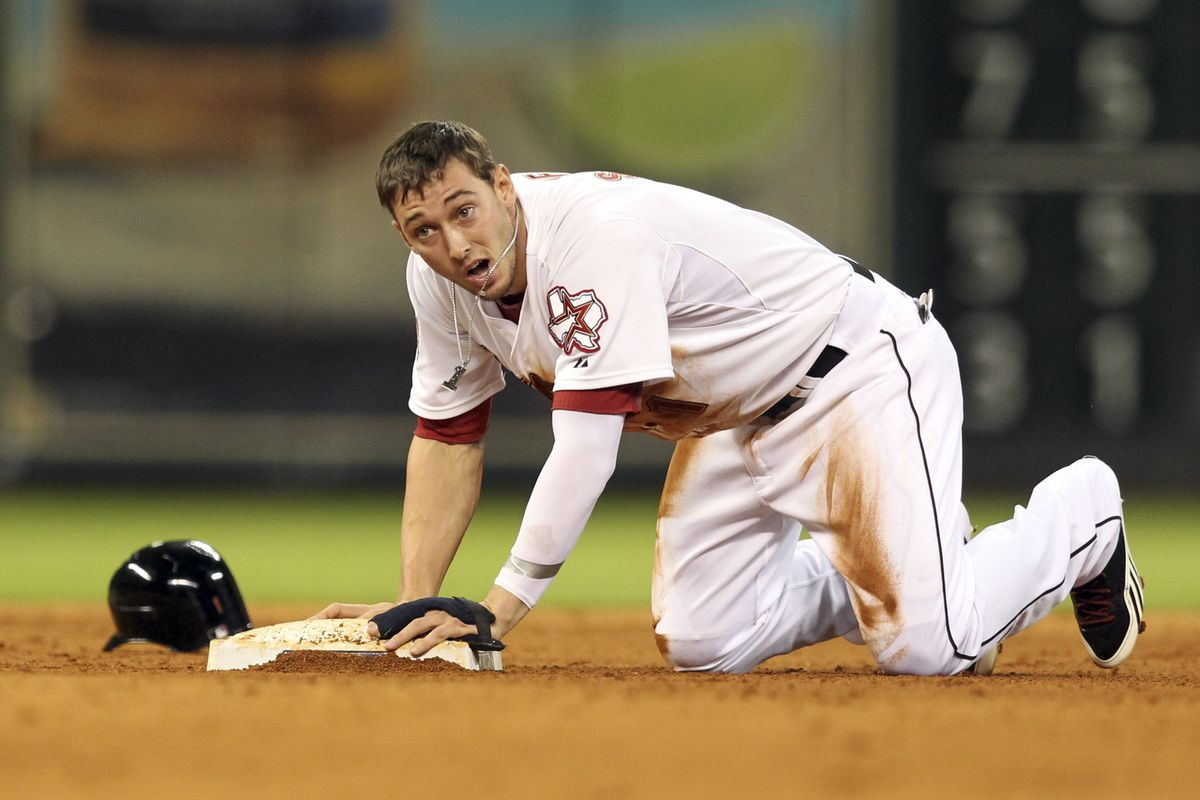HOUSTON TX - JULY 28: Jordan Schafer #1 of the Houston Astros steals second base in the ninth inning against the Pittsburgh Pirates at Minute Maid Park on July 28, 2012 in Houston, Texas. (Photo by Bob Levey/Getty Images)