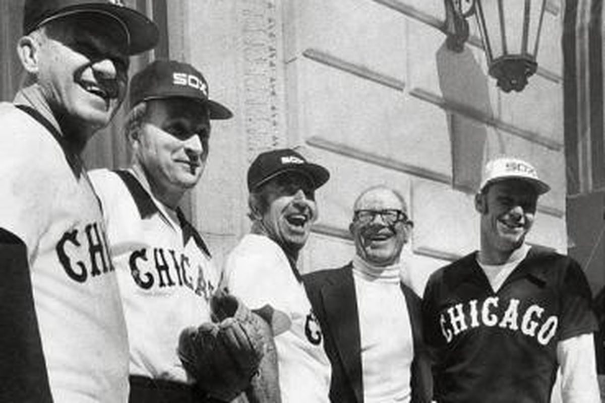Bill Veeck shows off his new uniforms