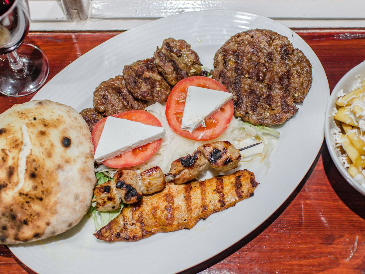 Grilled meat at the Queen's Arms —one of London's best Balkan restaurants