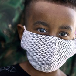 Sayedali Mowlid, 4, wears a face mask at a drive-thru car seat checkpoint at Shriners Hospitals for Children - Salt Lake City on Friday, Sept. 25, 2020. The checkpoint was an extension of the hospital's ongoing special needs car seat clinic, and a way to give back to the community.