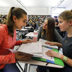 Students Isabel Roberts, left, Maura Borden and Anika Heilweil study for a test in Syd Lott's IB Economics class at Skyline High School in Salt Lake City, Tuesday, Oct. 20, 2015.