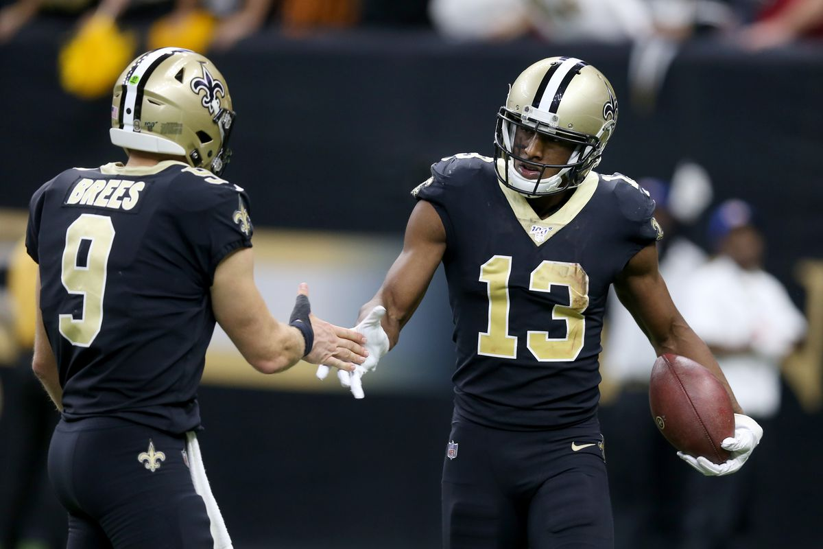 New Orleans Saints wide receiver Michael Thomas celebrates with quarterback Drew Brees after making a fourth quarter touchdown catch against the Arizona Cardinals at the Mercedes-Benz Superdome.