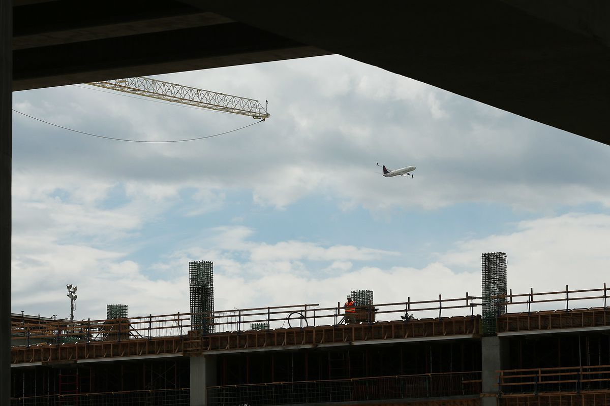 An airplane takes off during topping-out ceremony for the new terminal at the Salt Lake City International Airport in Salt Lake City on Wednesday, May 23, 2018.
