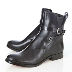 """<b>Kors</b> Adele Leather Boots, <a href=""""http://www.scoopnyc.com/shoes-and-handbags/shoes/boots/adele-leather-boots"""">$395</a> at Scoop"""