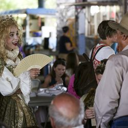 Lindsey Hardy, left, chats with Brent Green during the Utah Renaissance Faire at Thanksgiving Point's Electric Park Lehi on Friday, Aug. 23, 2019. Hardy and her husband traveled from Rexburg, Idaho, for the event.