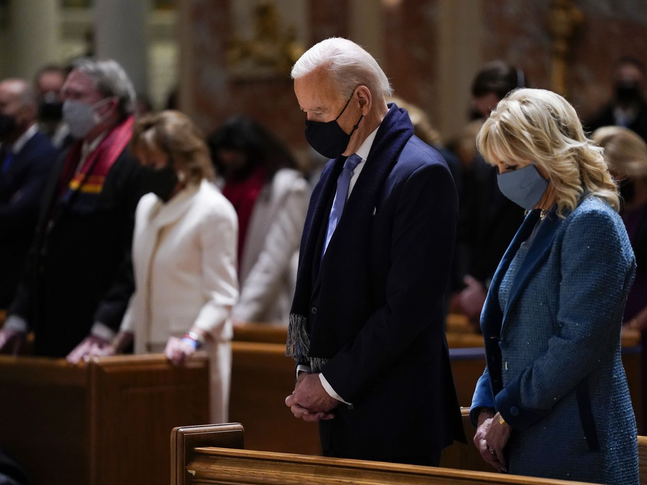 In this Wednesday, Jan. 20, 2021 file photo, President-elect Joe Biden and his wife, Jill Biden, attend Mass at the Cathedral of St. Matthew the Apostle during Inauguration Day ceremonies in Washington. When U.S. Catholic bishops hold their next national meeting in June 2021, they'll be deciding whether to send a tougher-than-ever message to President Joe Biden and other Catholic politicians: Don't partake of Communion if you persist in public advocacy of abortion rights.