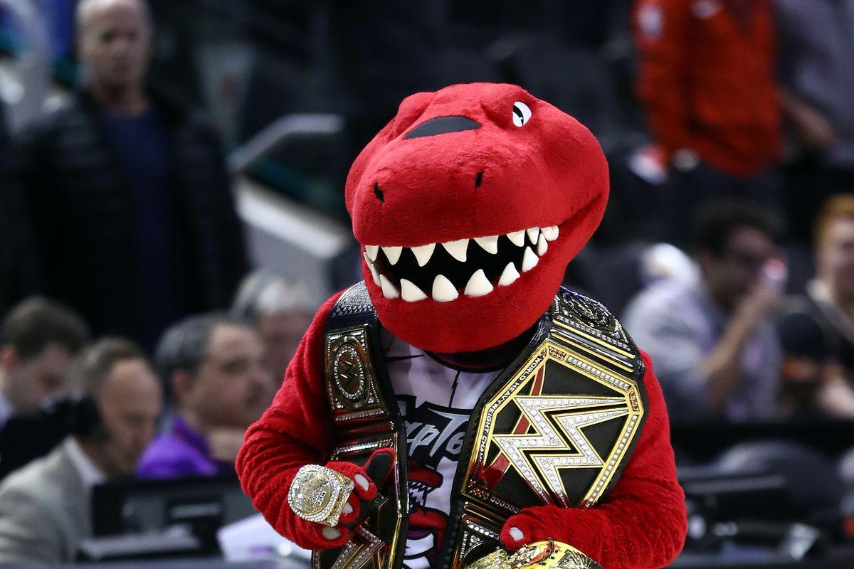 The Raptor holding multiple championship belts.