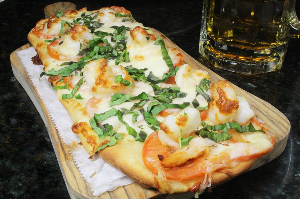 An oblong pizza from Mike's in Somerville, leaning more in the Roman style of pizza