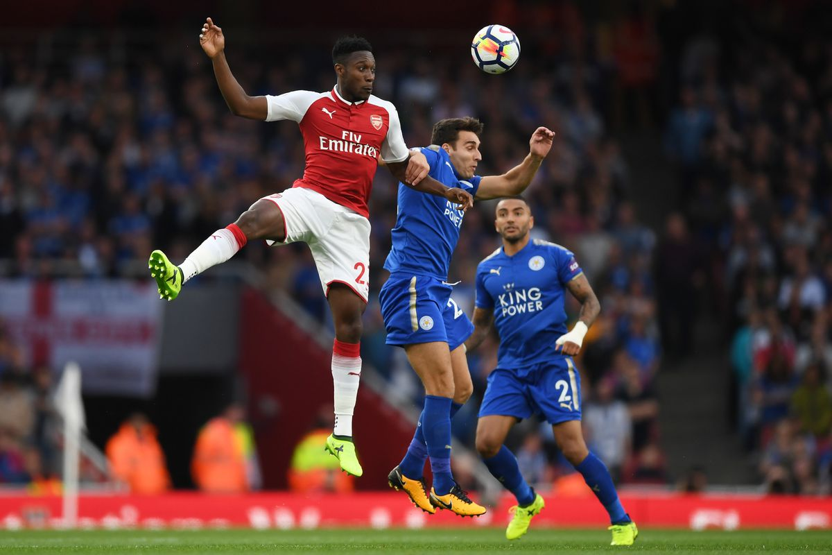 Matty James competes for a header with Danny Welbeck