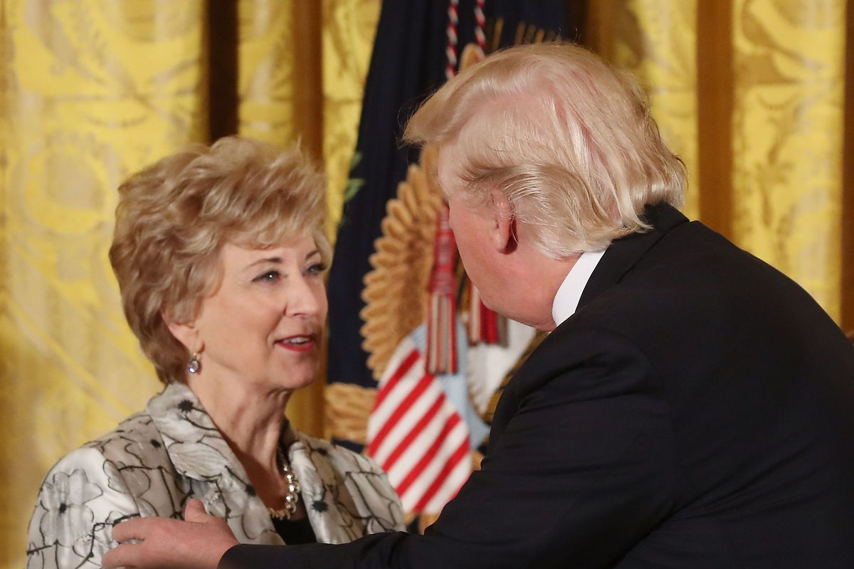 U.S. President Donald Trump shakes hands with  Small Business Administration head Linda McMahon