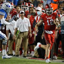 Utah Utes quarterback Charlie Brewer (12) runs past BYU's defense as they compete during the first half of an NCAA college football gameat LaVell Edwards Stadium in Provo on Saturday, Sept. 11, 2021.