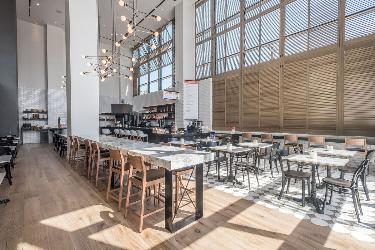 and then there is ever bar with its 28 foot ceilings and midcentury modern appeal the open lounge area is filled with leather chairs tall stools at a
