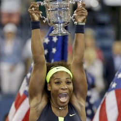 Serena Williams holds up the championship trophy after beating Victoria Azarenka in the championship match at the 2012 US Open tennis tournament, Sunday, Sept. 9, 2012, in New York.