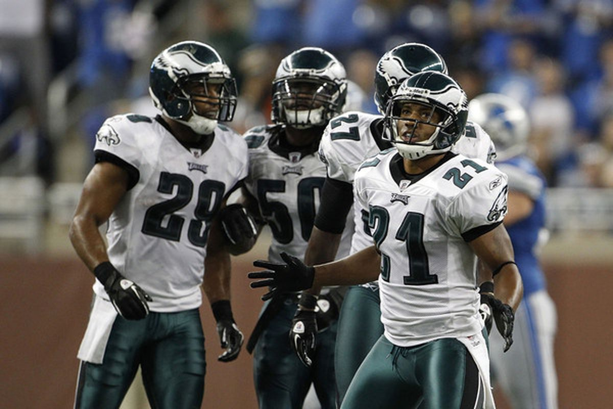 Joselio Hanson #21 and Nate Allen #29 of the Philadelphia Eagles celebrates after stoping the Detroit Lions on a fourth down play late in the game at Ford Field on September 19 2010