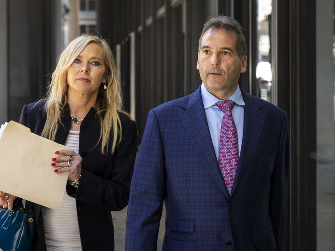 Vincent DelGiudice, right, walks with his attorney, Carolyn Gurland, out of the Dirksen Federal Courthouse in March 2020.
