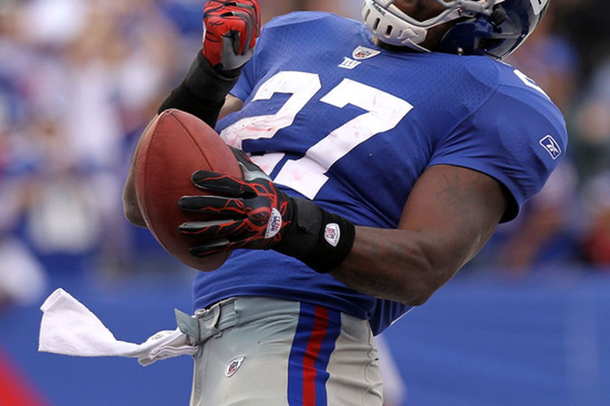 Brandon Jacobs (27) of the New York Giants celebrates his fourth quarter touchdown against  the Detroit Lions at New Meadowlands Stadium on October 17 2010 in East Rutherford New Jersey.  (Photo by Nick Laham/Getty Images)