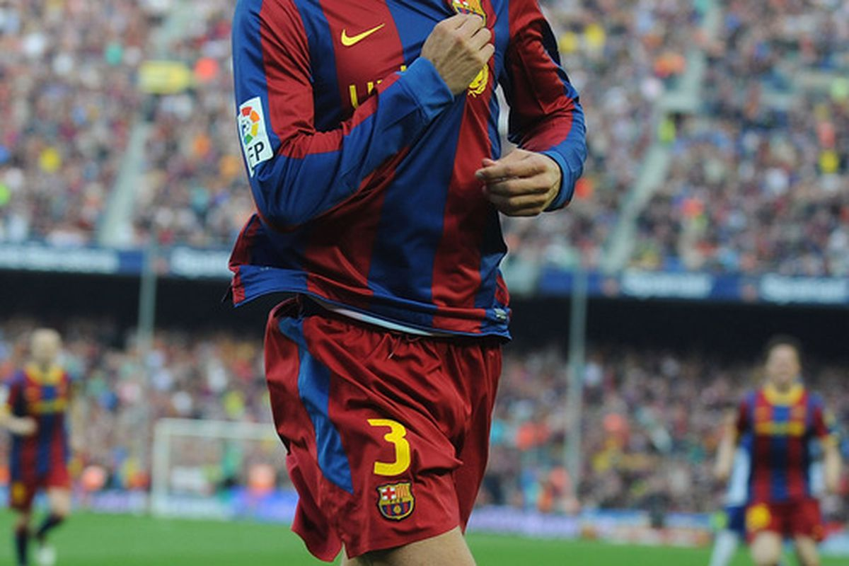 BARCELONA, SPAIN - MAY 08:  Gerard Pique of Barcelona celebrates after scoring his team's second goal during the La Liga match between Barcelona and Espanyol at Nou Camp on May 8, 2011 in Barcelona, Spain.  (Photo by Denis Doyle/Getty Images)