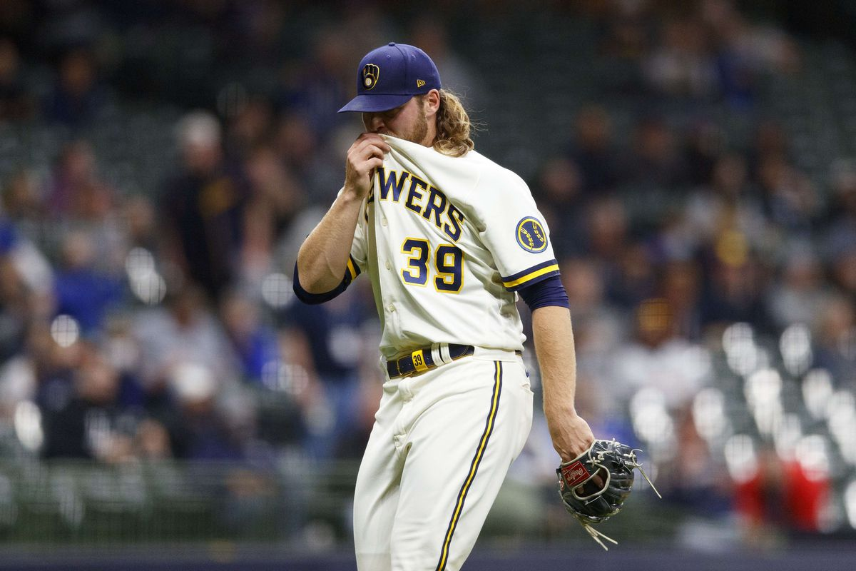 Milwaukee Brewers pitcher Corbin Burnes wipes his face after being removed from the game during the sixth inning against the Miami Marlins at American Family Field.