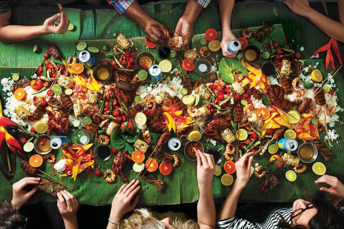 Overhead shot of a feast on banana leaves.