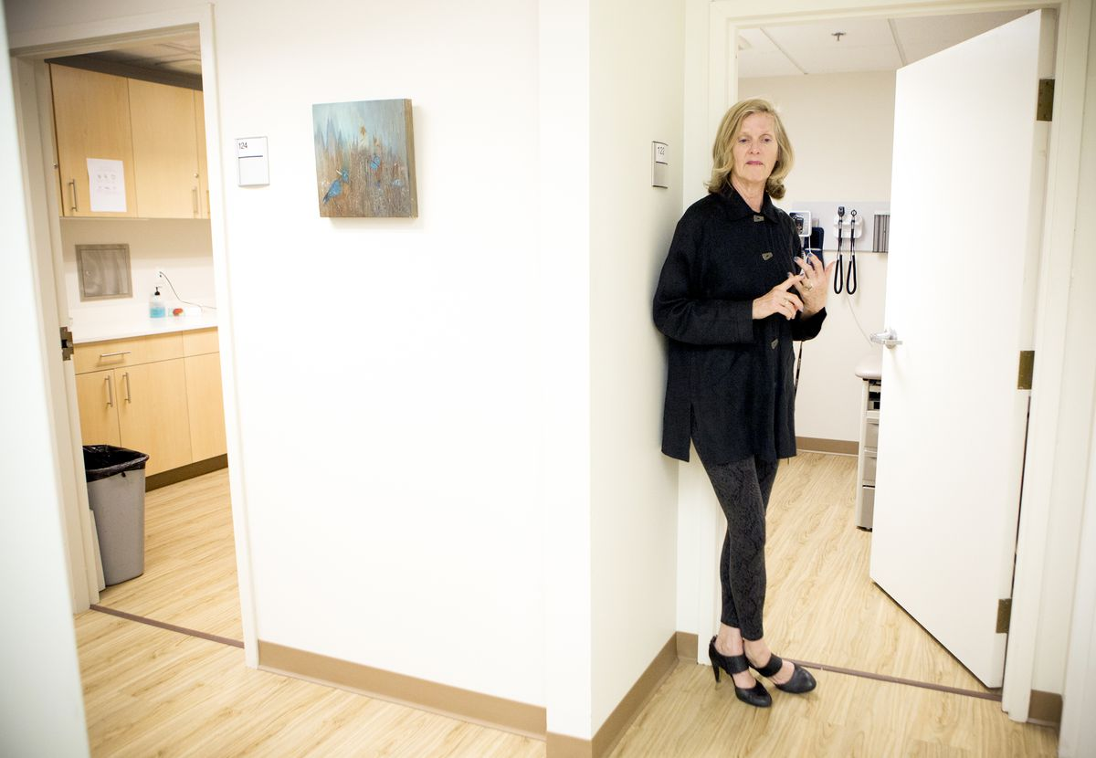 Daily Planet Health Services chief operating officer of advancement Maureen Neal stands outside a checkup room.