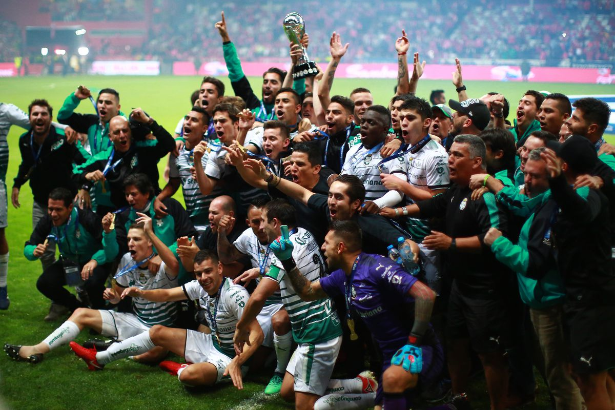 f5073d84892 Players of Santos Laguna celebrate with the Championship Trophy after the  Final second leg match between Toluca and Santos Laguna as part of the  Torneo ...