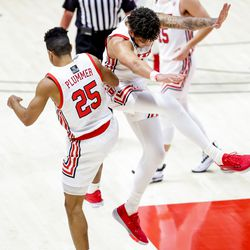 Utah Utes guard Alfonso Plummer (25) and forward Timmy Allen (1) celebrate after Plummer beat the first-half buzzer with a layup during the game against the California Golden Bears at the Huntsman Center in Salt Lake City on Saturday, Jan. 16, 2021.
