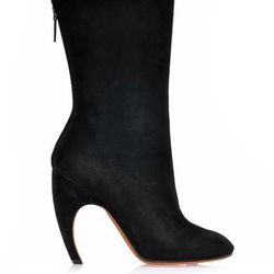 """<a href=""""http://www.matchesfashion.com/product/175460"""">Curved-heel suede boots by Givenchy</a>, $382.00 (were $1,195)"""